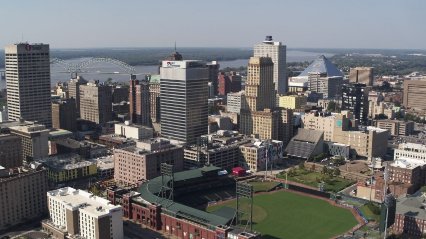 5.7K stock footage aerial video of flying toward tall office towers and a baseball stadium in Downtown Memphis, Tennessee Aerial Stock Footage | DX0002_179_006