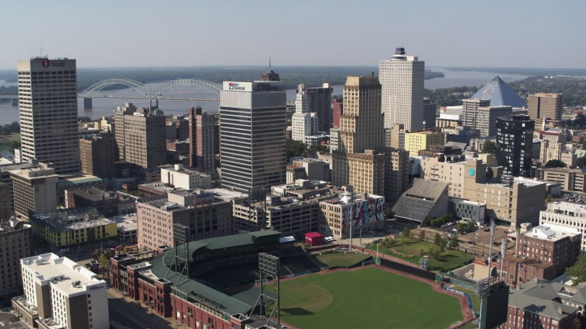 5.7K stock footage aerial video of an orbit of two office towers beside the baseball stadium in Downtown Memphis, Tennessee Aerial Stock Footage | DX0002_179_008