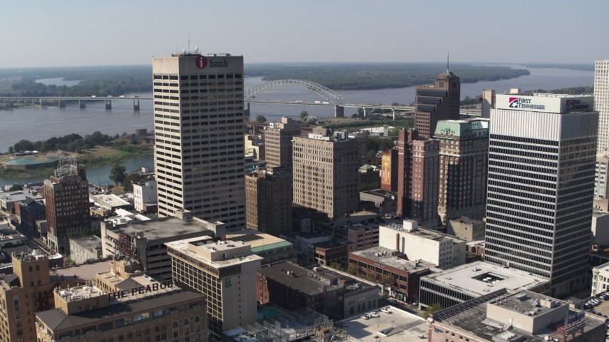 5.7K stock footage aerial video reverse view of the One Commerce Square office tower in Downtown Memphis, Tennessee Aerial Stock Footage | DX0002_179_010