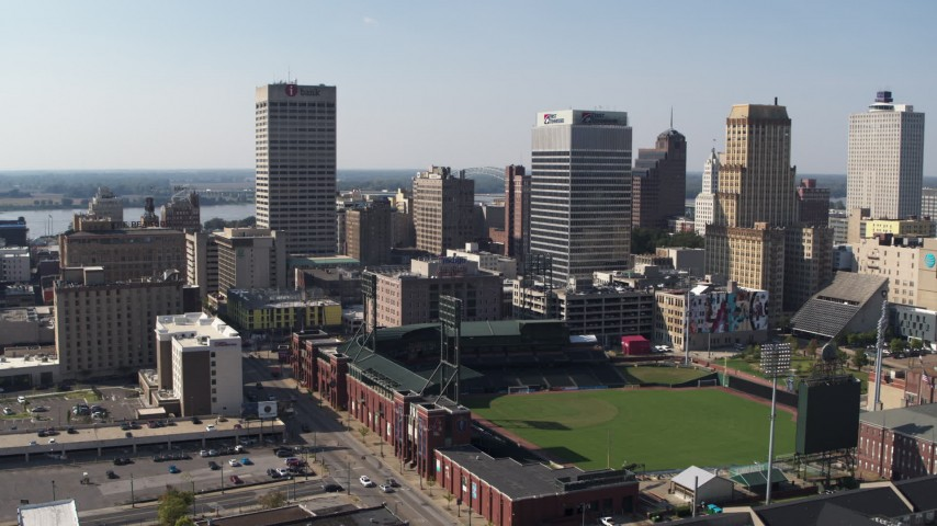 5.7K stock footage aerial video descend with view of baseball stadium and high-rise office towers in Downtown Memphis, Tennessee Aerial Stock Footage | DX0002_179_013
