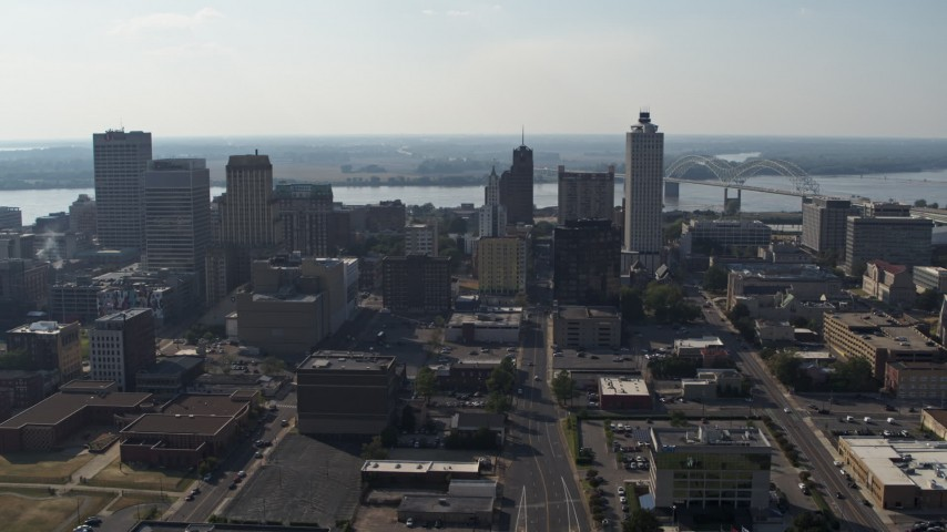 5.7K stock footage aerial video fly away from high-rise office buildings in Downtown Memphis, Tennessee skyline Aerial Stock Footage | DX0002_179_033
