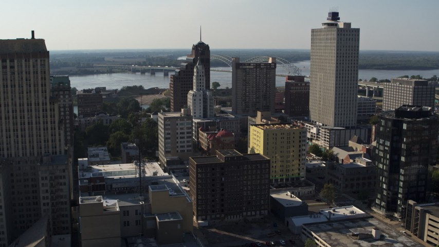 5.7K stock footage aerial video focus on Lincoln American Tower while passing office buildings in Downtown Memphis, Tennessee Aerial Stock Footage | DX0002_180_003