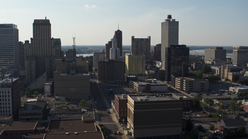 5.7K stock footage aerial video descend and approach Lincoln American Tower by taller office buildings in Downtown Memphis, Tennessee Aerial Stock Footage | DX0002_180_005