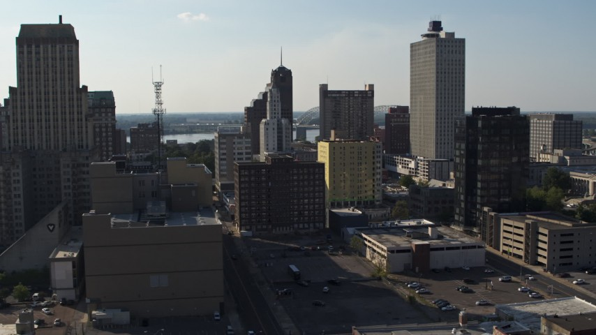 5.7K stock footage aerial video focus on Lincoln American Tower, ascend past taller office buildings in Downtown Memphis, Tennessee Aerial Stock Footage | DX0002_180_006