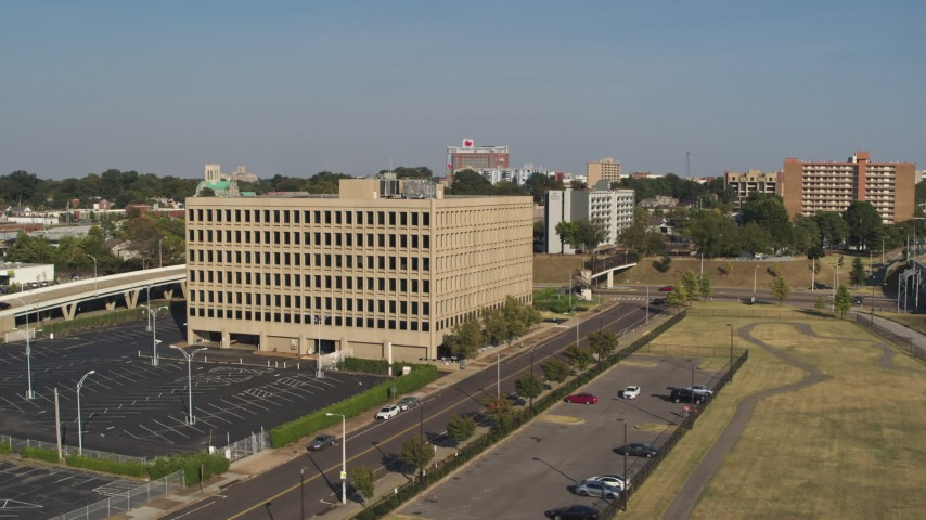 5.7K stock footage aerial video orbit and fly toward an office building, Downtown Memphis, Tennessee Aerial Stock Footage | DX0002_180_010