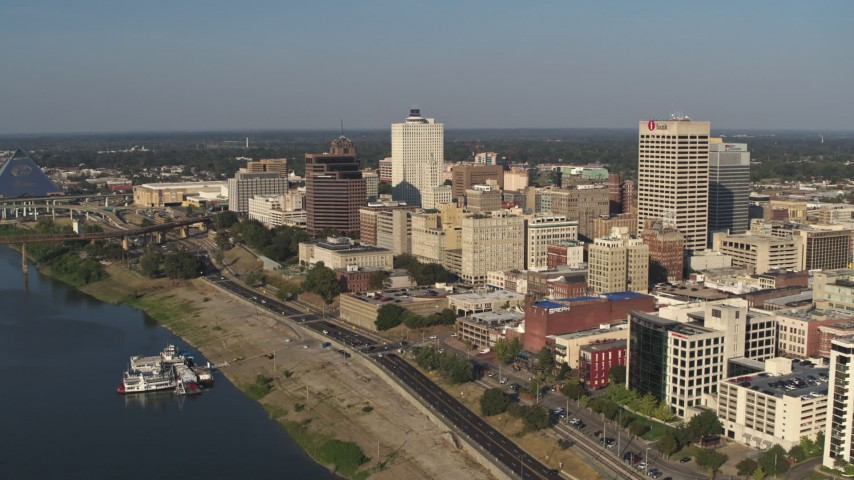 5.7K stock footage aerial video of flying by office buildings near Wolf River Harbor in Downtown Memphis, Tennessee Aerial Stock Footage | DX0002_180_014