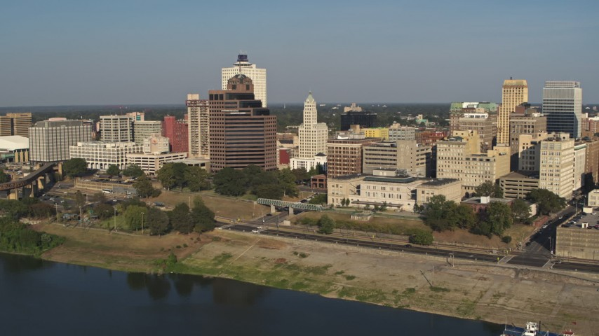 5.7K stock footage aerial video of office buildings near Wolf River Harbor during descent, Downtown Memphis, Tennessee Aerial Stock Footage | DX0002_180_016