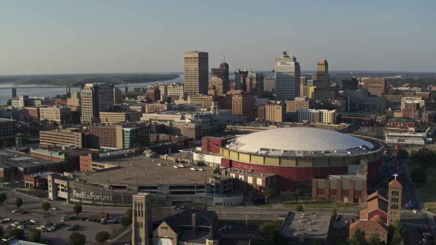 5.7K stock footage aerial video of approaching FedEx Forum arena and city skyline at sunset, Downtown Memphis, Tennessee Aerial Stock Footage | DX0002_180_021