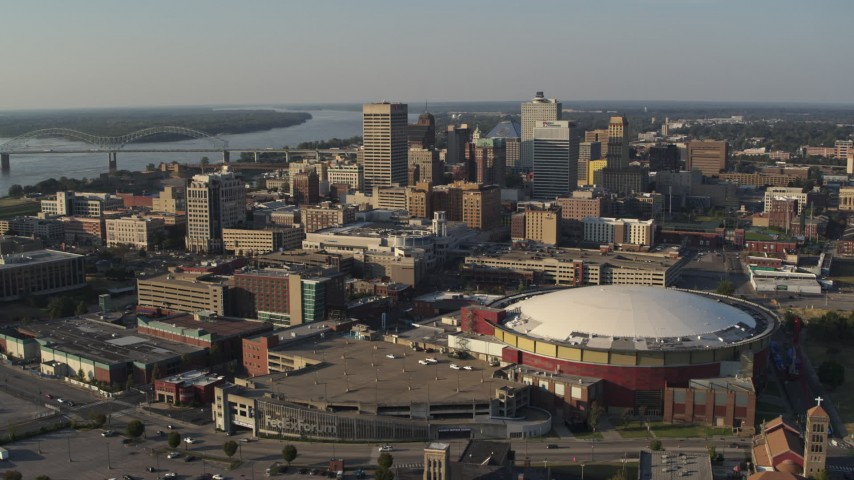 5.7K stock footage aerial video of ascend away from FedEx Forum arena and city skyline at sunset, Downtown Memphis, Tennessee Aerial Stock Footage | DX0002_180_022