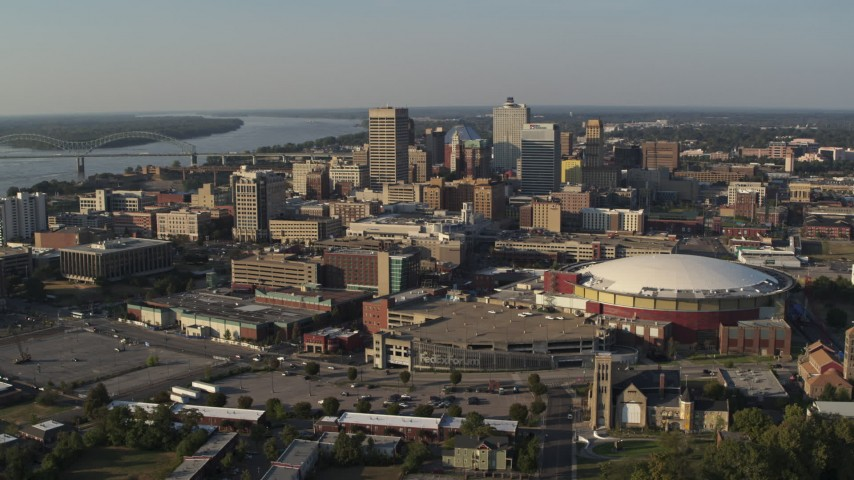5.7K stock footage aerial video of a view of FedEx Forum arena and the city skyline at sunset, Downtown Memphis, Tennessee Aerial Stock Footage DX0002_180_023 | Axiom Images