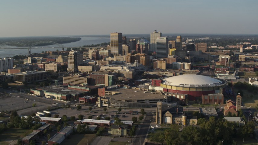 5.7K stock footage aerial video of a view of the city skyline seen while flying by FedEx Forum arena at sunset, Downtown Memphis, Tennessee Aerial Stock Footage | DX0002_180_024