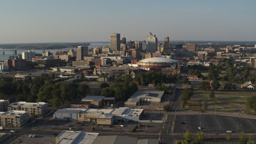 5.7K stock footage aerial video of a view of the city skyline and FedEx Forum arena during descent, Downtown Memphis, Tennessee, sunset Aerial Stock Footage | DX0002_180_026