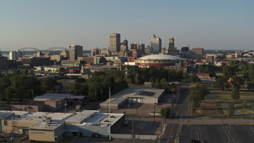 5.7K stock footage aerial video ascend toward the city skyline and FedEx Forum arena at sunset, Downtown Memphis, Tennessee Aerial Stock Footage | DX0002_180_027