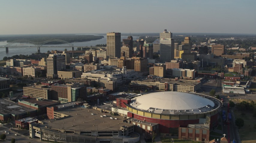 5.7K stock footage aerial video ascend and approach the city skyline and FedEx Forum arena at sunset, Downtown Memphis, Tennessee Aerial Stock Footage | DX0002_180_028