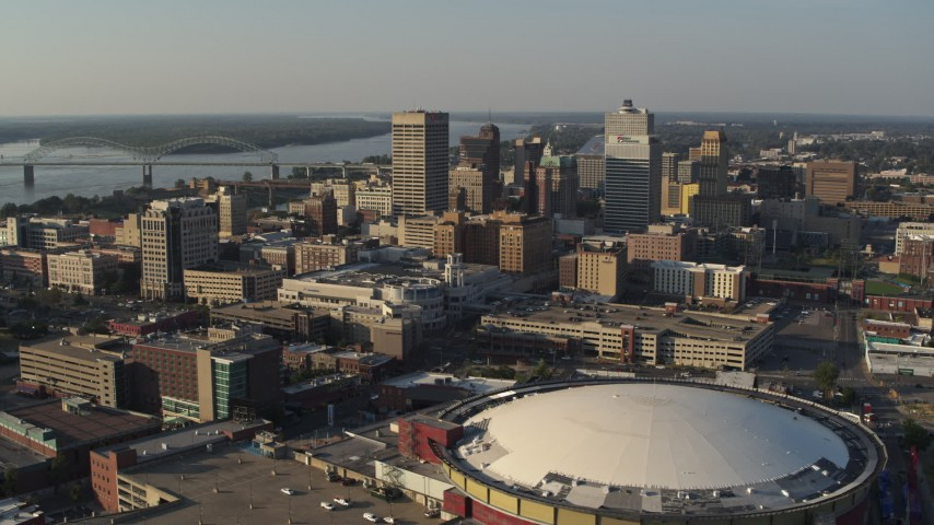 5.7K stock footage aerial video flyby the city skyline and FedEx Forum arena at sunset, Downtown Memphis, Tennessee Aerial Stock Footage | DX0002_180_029