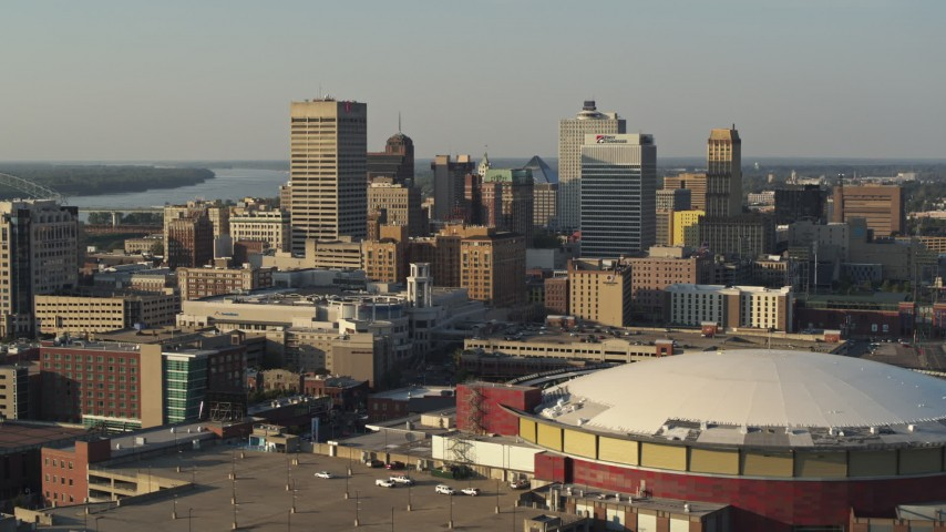 5.7K stock footage aerial video flying near FedEx Forum arena toward the skyline at sunset, Downtown Memphis, Tennessee Aerial Stock Footage | DX0002_180_032