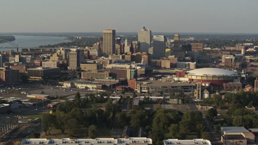 5.7K stock footage aerial video passing FedEx Forum arena while focused on the skyline at sunset, Downtown Memphis, Tennessee Aerial Stock Footage | DX0002_180_034