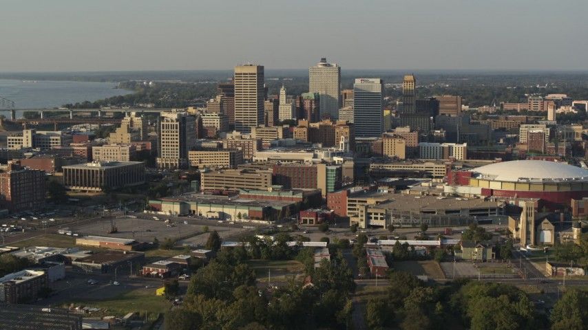 5.7K stock footage aerial video flying by the skyline and near FedEx Forum arena at sunset, Downtown Memphis, Tennessee Aerial Stock Footage | DX0002_180_035