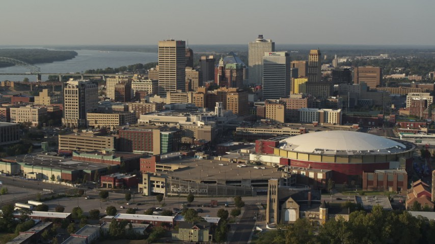 5.7K stock footage aerial video flying by the skyline behind FedEx Forum arena at sunset, Downtown Memphis, Tennessee Aerial Stock Footage | DX0002_180_036