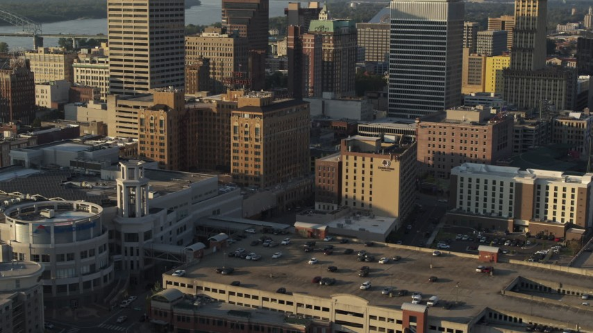 5.7K stock footage aerial video ascend over FedEx Forum arena at sunset toward hotel in Downtown Memphis, Tennessee Aerial Stock Footage | DX0002_180_038
