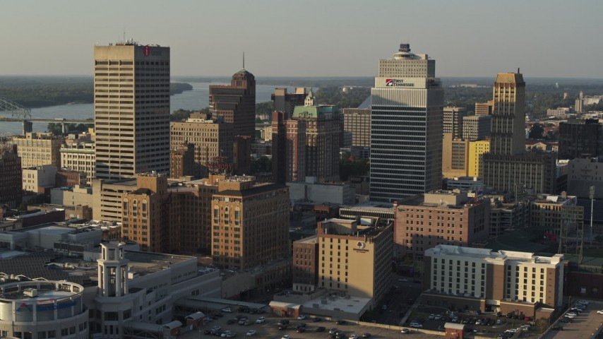 5.7K stock footage aerial video fly away from office towers at sunset in Downtown Memphis, Tennessee Aerial Stock Footage | DX0002_180_039