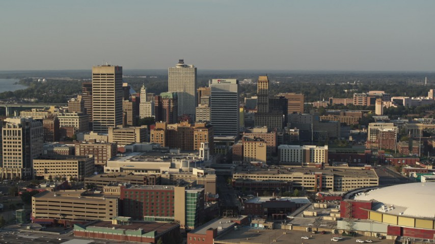 5.7K stock footage aerial video slowly flyby office towers at sunset seen from the arena, Downtown Memphis, Tennessee Aerial Stock Footage | DX0002_180_041