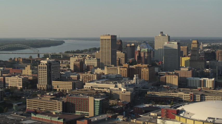 5.7K stock footage aerial video of office towers at sunset, seen while passing the arena, Downtown Memphis, Tennessee Aerial Stock Footage | DX0002_180_042
