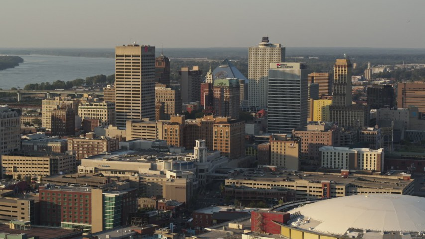 5.7K stock footage aerial video of office towers at sunset, seen while passing roof of the arena, Downtown Memphis, Tennessee Aerial Stock Footage | DX0002_181_001