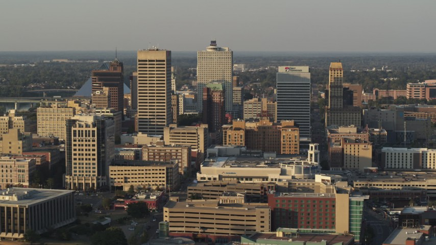 5.7K stock footage aerial video of flying past office towers at sunset, Downtown Memphis, Tennessee Aerial Stock Footage | DX0002_181_002
