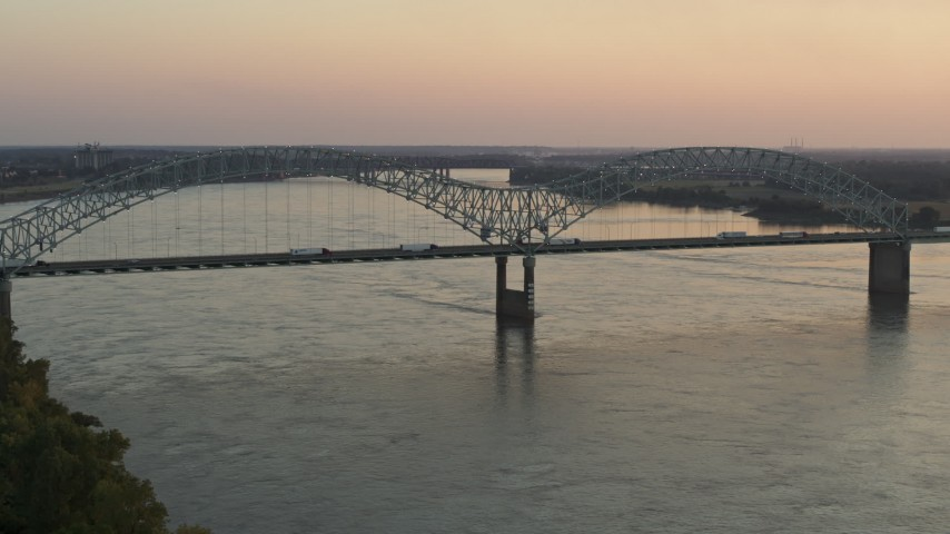 5.7K stock footage aerial video of traffic crossing the Hernando de Soto Bridge at sunset, Downtown Memphis, Tennessee Aerial Stock Footage | DX0002_181_016