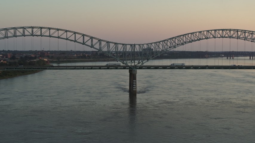 5.7K stock footage aerial video a view of traffic crossing the Hernando de Soto Bridge at sunset, Downtown Memphis, Tennessee Aerial Stock Footage | DX0002_181_018