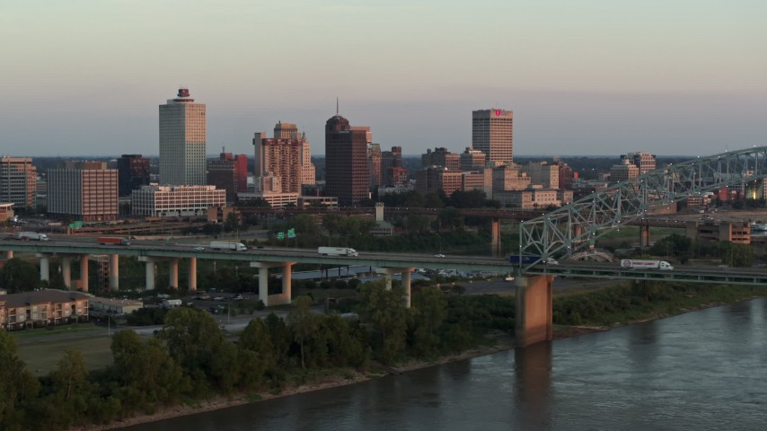 5.7K stock footage aerial video focus on the city's skyline behind the bridge at sunset, Downtown Memphis, Tennessee Aerial Stock Footage | DX0002_181_019