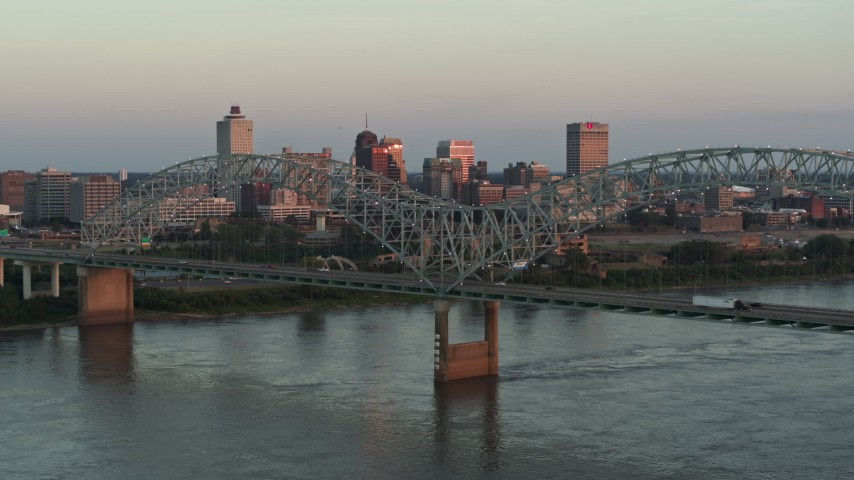 5.7K stock footage aerial video of the city's skyline as traffic crosses the bridge at sunset, Downtown Memphis, Tennessee Aerial Stock Footage | DX0002_181_021