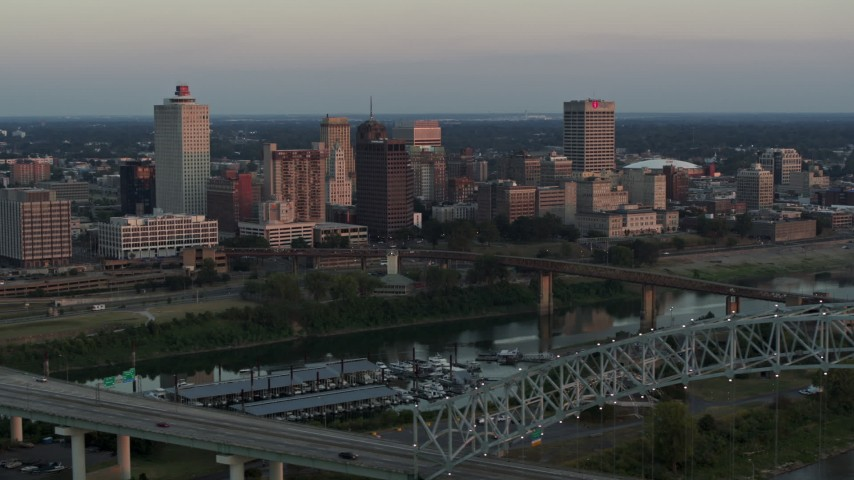 5.7K stock footage aerial video of the city's skyline seen from the Hernando de Soto Bridge at sunset in Downtown Memphis, Tennessee Aerial Stock Footage | DX0002_181_023