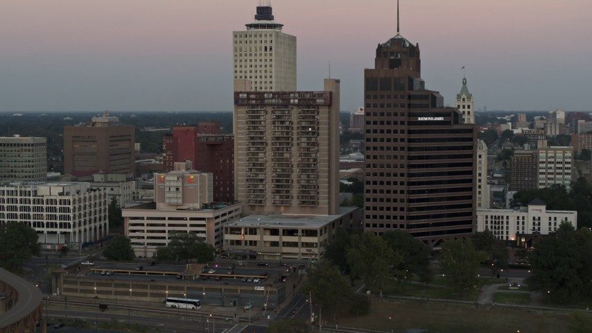5.7K stock footage aerial video flying by apartment and office high-rises at sunset in Downtown Memphis, Tennessee Aerial Stock Footage | DX0002_181_029