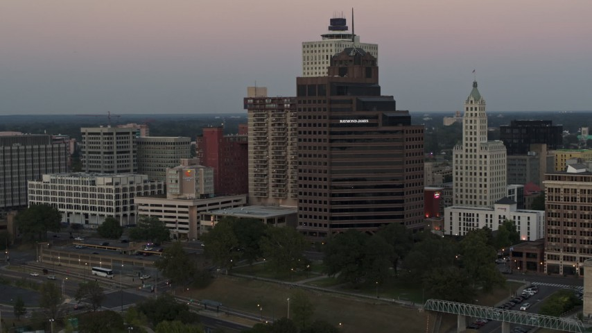 5.7K stock footage aerial video flying by and office high-rise at sunset in Downtown Memphis, Tennessee Aerial Stock Footage | DX0002_181_030