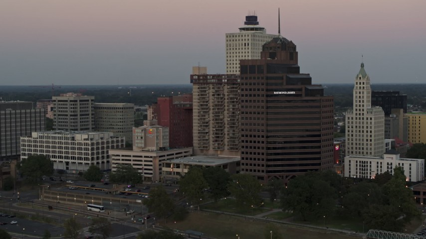 5.7K stock footage aerial video flying by office tower and apartment high-rise at sunset in Downtown Memphis, Tennessee Aerial Stock Footage | DX0002_181_031