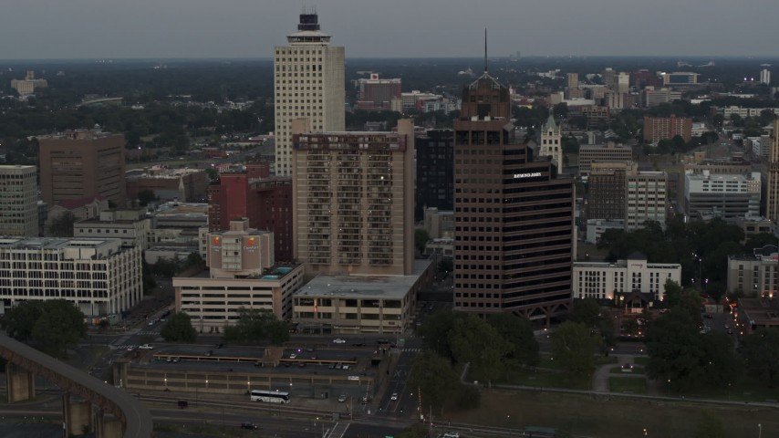 5.7K stock footage aerial video passing by apartment high-rise and office tower at sunset in Downtown Memphis, Tennessee Aerial Stock Footage | DX0002_181_032