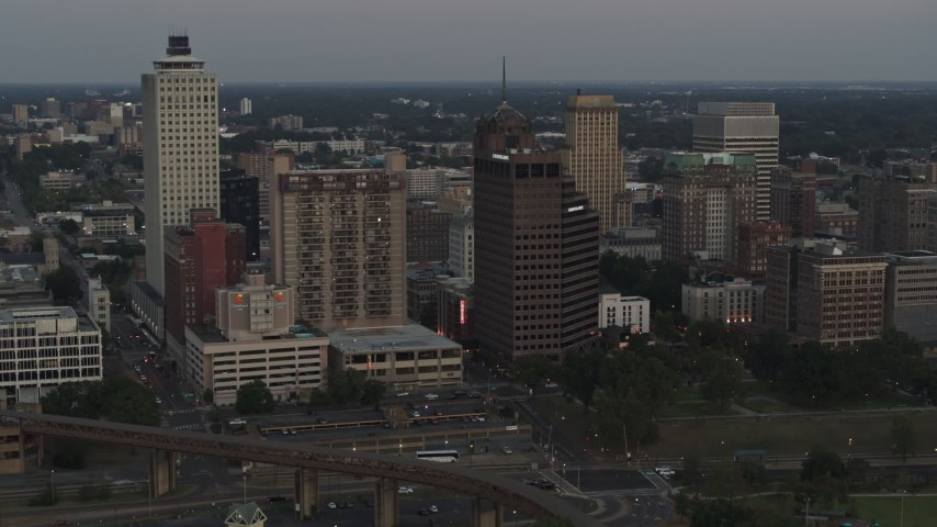 5.7K stock footage aerial video of passing office and apartment high-rises at sunset in Downtown Memphis, Tennessee Aerial Stock Footage | DX0002_181_033