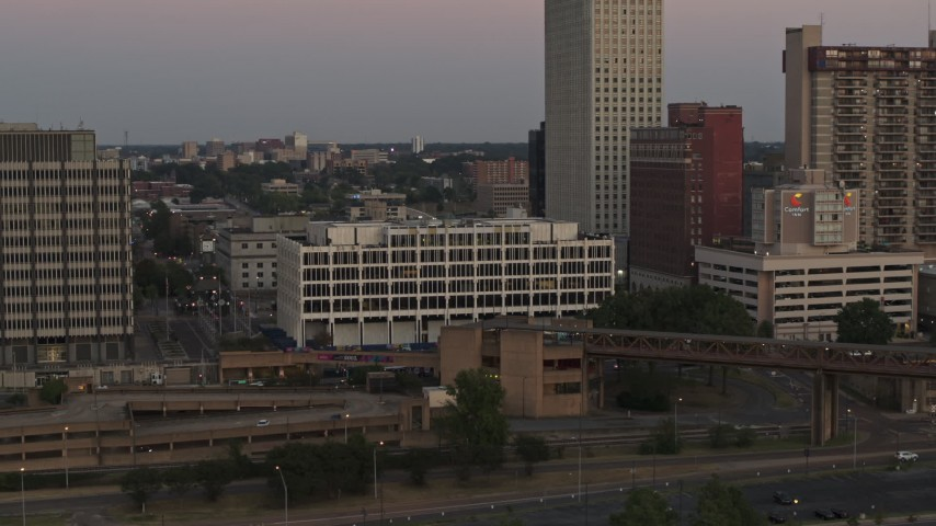 5.7K stock footage aerial video of a reverse view of Memphis City Hall at sunset in Downtown Memphis, Tennessee Aerial Stock Footage | DX0002_181_037