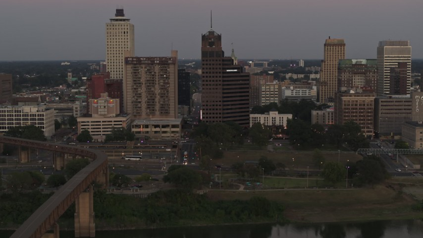 5.7K stock footage aerial video pass apartment and office high-rises at sunset in Downtown Memphis, Tennessee Aerial Stock Footage | DX0002_181_039