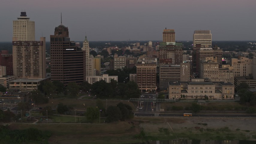 5.7K stock footage aerial video Raymond Jame Tower and office buildings at sunset in Downtown Memphis, Tennessee Aerial Stock Footage | DX0002_181_040