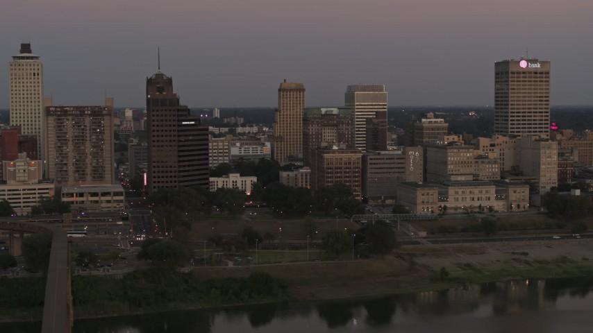 5.7K stock footage aerial video a view across the river at the skyline at sunset in Downtown Memphis, Tennessee Aerial Stock Footage | DX0002_181_041