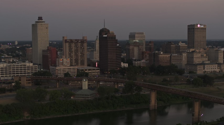 5.7K stock footage aerial video a view across the river at the city's skyline at sunset in Downtown Memphis, Tennessee Aerial Stock Footage | DX0002_181_042