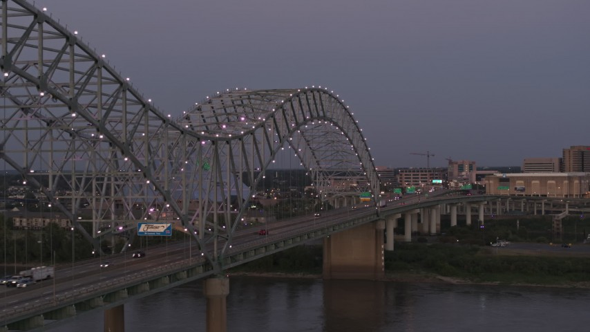 5.7K stock footage aerial video fly beside the Hernando de Soto Bridge at twilight toward Downtown Memphis, Tennessee Aerial Stock Footage | DX0002_181_046