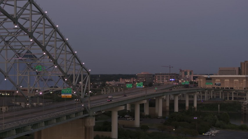5.7K stock footage aerial video passing the Memphis side of the Hernando de Soto Bridge at twilight, Downtown Memphis, Tennessee Aerial Stock Footage | DX0002_181_047