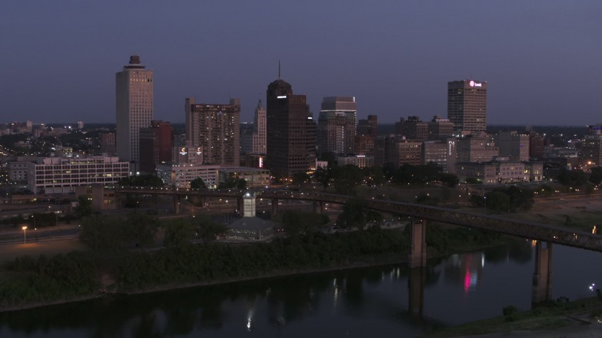 5.7K stock footage aerial video a stationary view across the river at the city's skyline at twilight in Downtown Memphis, Tennessee Aerial Stock Footage | DX0002_182_001