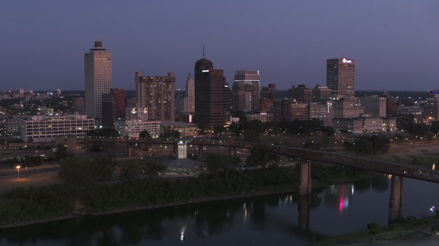 5.7K stock footage aerial video a stationary view across Wolf River Harbor at the city's skyline at twilight in Downtown Memphis, Tennessee Aerial Stock Footage | DX0002_182_002