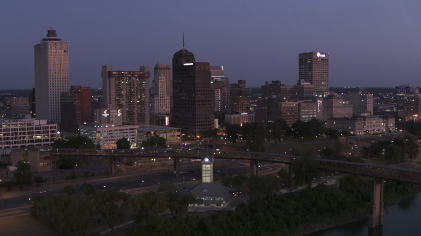 5.7K stock footage aerial video of flying by the city's skyline across the river at twilight in Downtown Memphis, Tennessee Aerial Stock Footage | DX0002_182_003