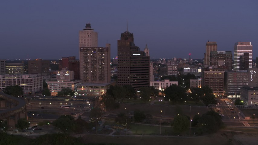 5.7K stock footage aerial video of orbiting apartment and office high-rises at twilight in Downtown Memphis, Tennessee Aerial Stock Footage | DX0002_182_004